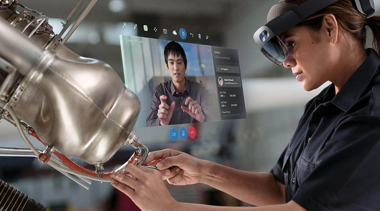 Simulated real-life photo of a field technician wearing a HoloLens and communicating with a remote expert.